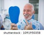 smiling and satisfied patient... | Shutterstock . vector #1091950358
