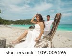attractive young couple on the... | Shutterstock . vector #1092009596