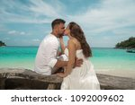 attractive young couple on the... | Shutterstock . vector #1092009602