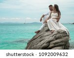 attractive young couple on the... | Shutterstock . vector #1092009632
