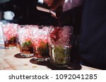 preparation of long cocktails.... | Shutterstock . vector #1092041285
