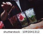 preparation of long cocktails.... | Shutterstock . vector #1092041312