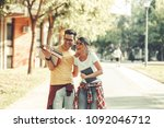 young student couple going to... | Shutterstock . vector #1092046712