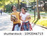 young student couple going to... | Shutterstock . vector #1092046715