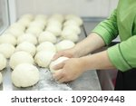 the cook kneads pieces of dough ... | Shutterstock . vector #1092049448