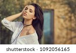smiling summer woman with... | Shutterstock . vector #1092056165