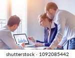 accounting team discussing... | Shutterstock . vector #1092085442