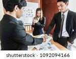 businessmen shaking hands...   Shutterstock . vector #1092094166