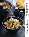 poke bowl with salmon and... | Shutterstock . vector #1092097355