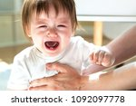 upset toddler boy crying while... | Shutterstock . vector #1092097778
