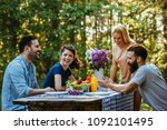 cropped shot of a group of... | Shutterstock . vector #1092101495