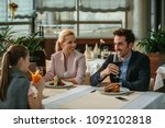 happy family having lunch in a... | Shutterstock . vector #1092102818