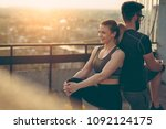 young couple on a building... | Shutterstock . vector #1092124175