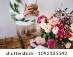 florist makes a bouquet. | Shutterstock . vector #1092135542