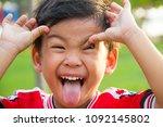 close up portrait of child. he... | Shutterstock . vector #1092145802