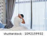 man stretching in bed after... | Shutterstock . vector #1092159932