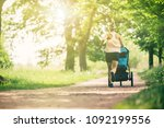 running woman with baby... | Shutterstock . vector #1092199556