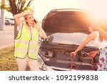 girls are trying to fix the... | Shutterstock . vector #1092199838
