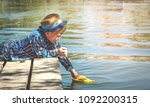 boy launch toy ship or boat... | Shutterstock . vector #1092200315