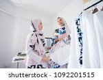 two young and dynamic muslim... | Shutterstock . vector #1092201515