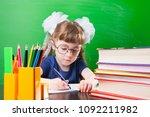 little girl writing in copybook ... | Shutterstock . vector #1092211982
