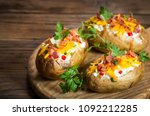 baked potatoes with cheese and... | Shutterstock . vector #1092212285