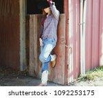 strong woman in western wear on ... | Shutterstock . vector #1092253175