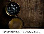 bronze compass on aged ...   Shutterstock . vector #1092295118