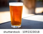 macro close up on a cold pint... | Shutterstock . vector #1092323018