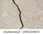 crack in the wall. concrete ... | Shutterstock . vector #1092324872
