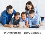 large family with gadgets....   Shutterstock . vector #1092388088