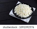 cottage cheese on a dark wooden ... | Shutterstock . vector #1092392576