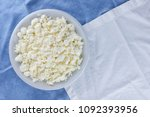 cottage cheese on a white blue... | Shutterstock . vector #1092393956