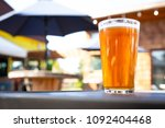 close up on a pint glass of... | Shutterstock . vector #1092404468