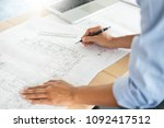 person's engineer hand drawing... | Shutterstock . vector #1092417512