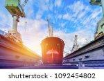 cargo ship under repair... | Shutterstock . vector #1092454802