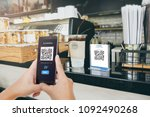 Small photo of Qr code payment, E wallet , cashless technology concept illustration. Man scanning tag in Coffee shop accepted generate digital pay without money.