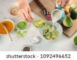woman making nourishing mask... | Shutterstock . vector #1092496652