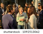 diverse people mingling at an... | Shutterstock . vector #1092513062