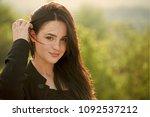 woman touch long brunette hair...   Shutterstock . vector #1092537212