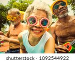 cool seniors acting youtful by... | Shutterstock . vector #1092544922