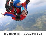 tandem skydiving. man and woman ... | Shutterstock . vector #1092546635