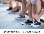 close up on school kids' legs... | Shutterstock . vector #1092548615