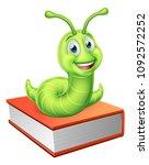 a cute caterpillar bookworm... | Shutterstock .eps vector #1092572252