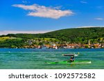 a kayaker on lake constance on... | Shutterstock . vector #1092572582