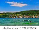 a kayaker on lake constance on... | Shutterstock . vector #1092572585