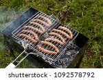 fresh sausages are cooked on... | Shutterstock . vector #1092578792