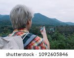 young man trekker searching... | Shutterstock . vector #1092605846