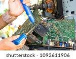 technician repairs circuit... | Shutterstock . vector #1092611906