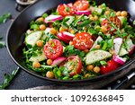 salad of chickpeas  tomatoes ... | Shutterstock . vector #1092636845